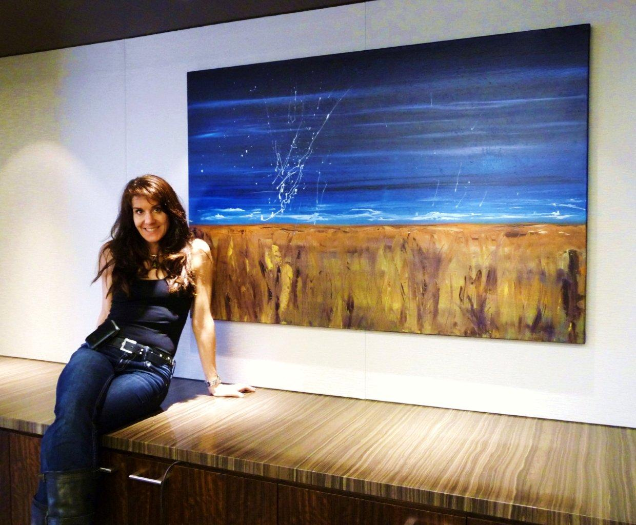 Leanne Venier with her healing blue painting, Immortal Evanescence installed in Houston Client's 2nd conference room