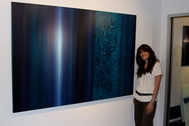 Image of Leanne and her 6 foot x4 foot Teal healing colors painting