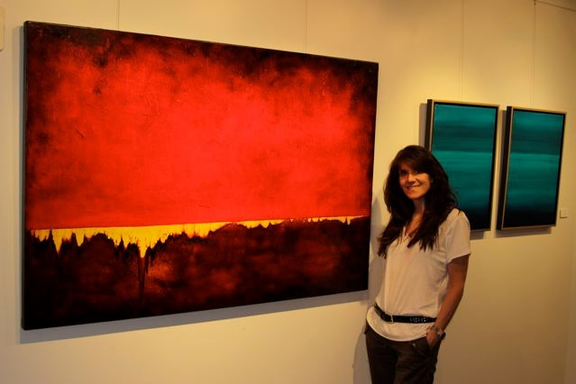 Photo of Leanne with her Energizing RED painting