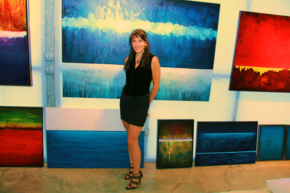 Leanne Venier with her Healing Abstract Oil Paintings in her Leanne Venier Gallery