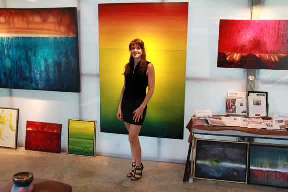 Leanne Venier in her gallery with her paintings - Int'l award-winning artist, Engineer and science of Color, Light & Flow State Expert