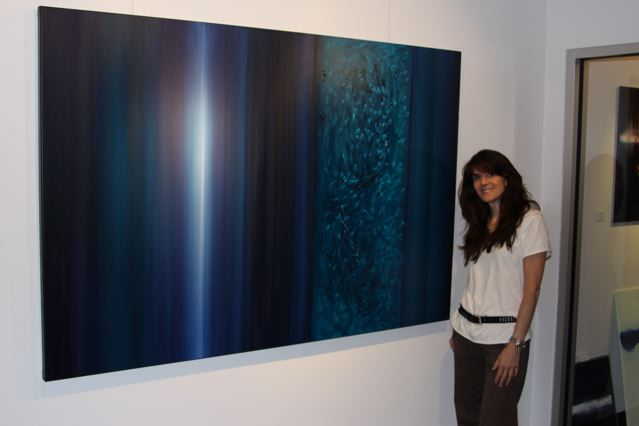 Leanne Venier with her healing painting, Ageless, Boundless, Timeless